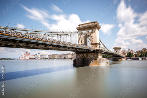 Keuken foto achterwand Boedapest Landscape view on the Chain bridge on Danube river during the daylight in Budapest city, Hungary. Long exposure image technic