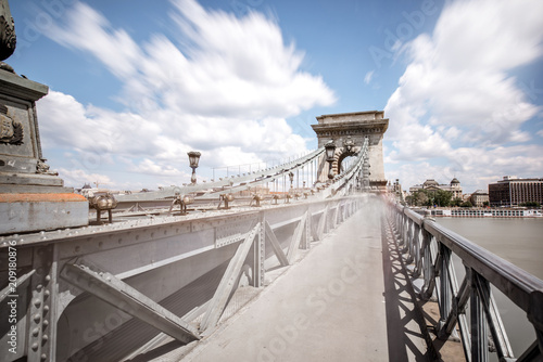 Fotobehang Centraal Europa View on the pedestrian way with motion blurred people on the Chain bridge in Budapest city, Hungary