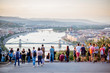People enjoying great view on Budapest city with Danube river and bridge during the sunset in Hungary. People is out of focus