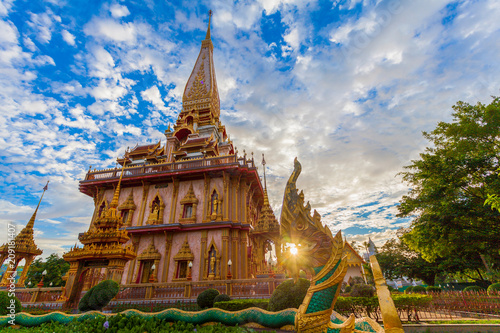 Montage in der Fensternische Tempel cloudy sunset above beautiful pagoda in Chalong temple Phuket Thailand