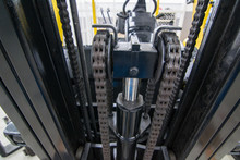 Close Up Forklift Chain, Oiled Mechanical Chain On A Forklift Truck