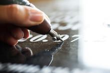 Girl Engraves On Granite