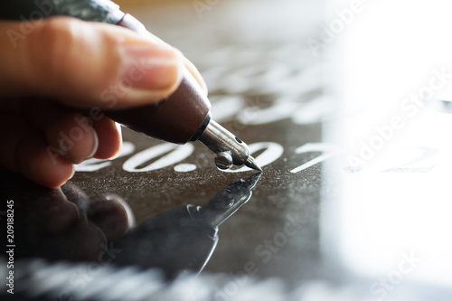 Girl engraves on granite Canvas Print