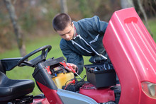 Mechanic Working On Mower