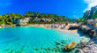 Leinwandbild Motiv Panoramic view of Cala Llombards beach with turquoise clean water in Mallorca island, Spain