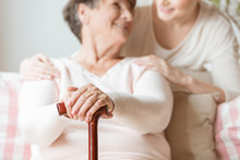 Close-up Of Elderly Woman Hold...
