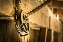 Vintage Pulley And Rope In Old Barn