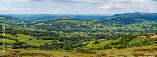 Valokuva  Panoramic aerial view of green farmland and fields in the rural Welsh countrysid