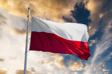 Polish Flag Waving Against Sun...