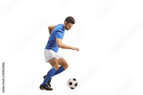 Soccer player dribbling Tablou Canvas