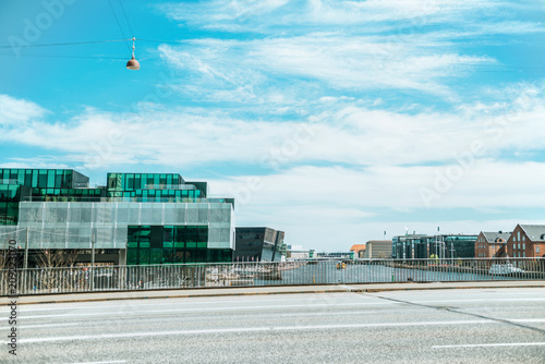 urban scene with beautiful architecture of copenhagen and cloudy sky, denmark Poster