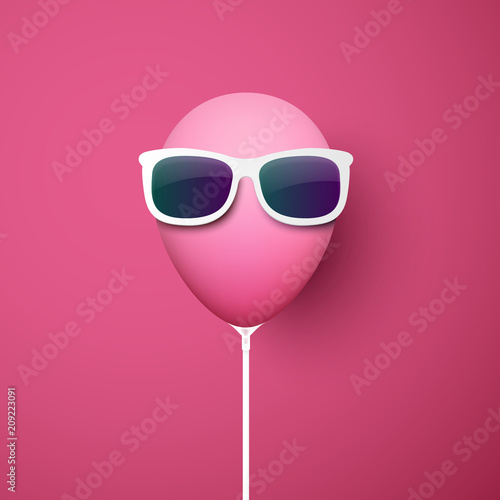 Pink background with funny balloon in sunglasses. Wallpaper Mural