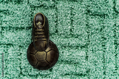 Valokuva Soccer concept. Football, soccer ball with old soccer cleat