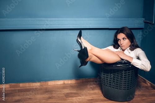 Fotografie, Obraz  Gorgeous woman in trash can