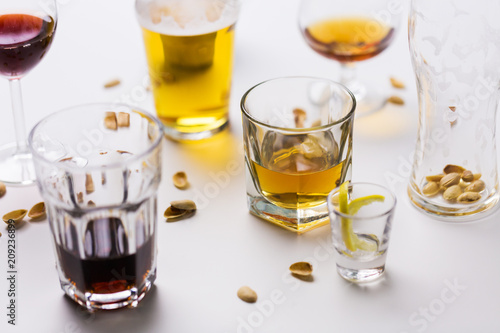 Cuadros en Lienzo alcohol addiction and drunkenness concept - glasses of different drinks on messy
