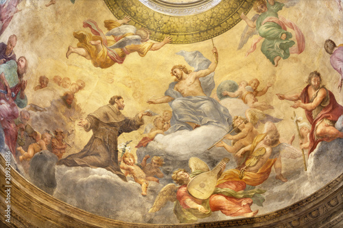 PARMA, ITALY - APRIL 15, 2018: The fresco of Jesus with the St. Francis of Assisi in side cupola of church Chiesa di Santa Cristina by Filippo Maria Galletti (1636-1714).