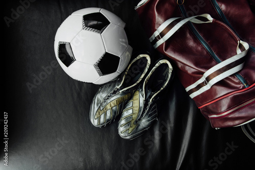 Valokuvatapetti Flat lay soccer football accessories on a dark leather background