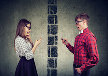 Shocked Couple Man And Woman Separated By Wall Texting Each Other On Mobile Phone