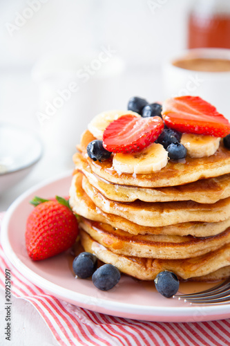 Homemade pancakes with berries and banana