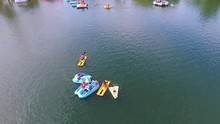 Aerial Shot Of Young People Playing With Water Toys On Clear Blue Lake In The Summer