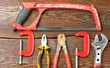 Workshop bench. Variety of hand tools on a wooden table, top view, copy space