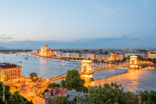 Papiers peints Europe Centrale Aerial cityscape view with illuminated Chain bridge and famous Parliament building during the twilight in Budapest, Hungary