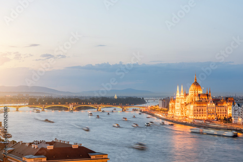 Fotobehang Centraal Europa Aerial cityscape view with motion blurred ships and illuminated Parliament building during the twilight in Budapest, Hungary
