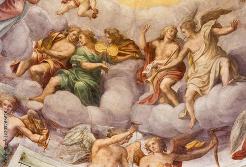 Valokuva PARMA, ITALY - APRIL 16, 2018: The freso of angels with the music intstruments in the cupola of church Chiesa di Santa Croce by Giovanni Maria Conti della Camera (1614 - 1670)