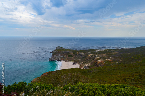 Fotografering  Cape of Good Hope, South Africa, looking towards the west, from the coastal cliffs above Cape Point, overlooking Dias beach