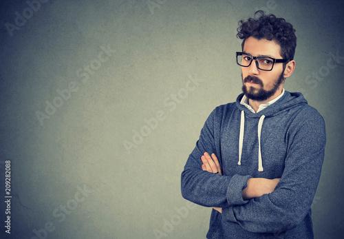 Obraz na plátně Envy offended man with hands crossed