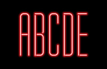 Bright Red Neon Letters On A B...