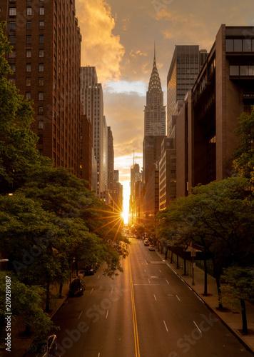 Fototapeta Manhattanhenge when the sun sets along 42nd street in NY obraz