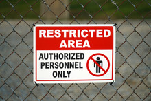 Close Up On Restricted Area Sign On The Iron Fence