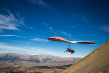 Hang Gliding High In The Mountains