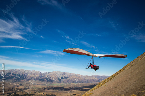 Slika na platnu Hang gliding high in the mountains