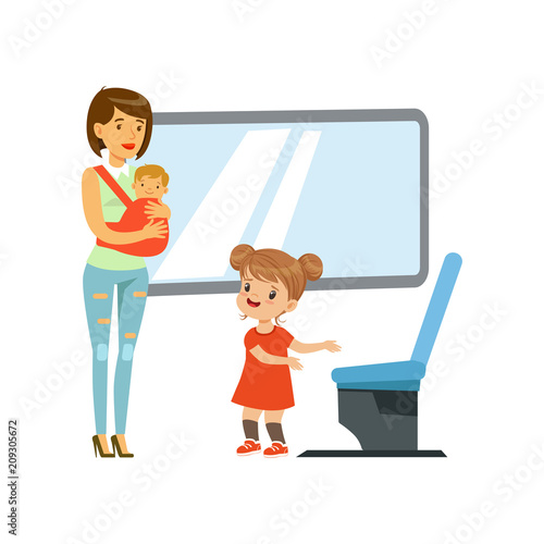 Little girl giving way to woman with baby in public transport, kids good manners Canvas-taulu