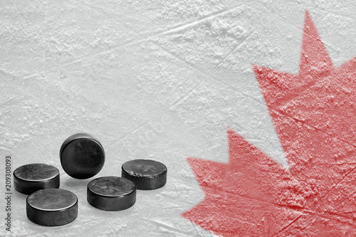 Canadian maple leaf image on ice with hockey puck