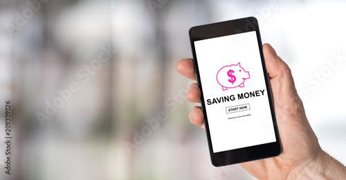 Fotografía  Saving money concept on a smartphone