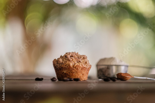 Fotografie, Obraz  Mocha muffins and ingredients on a rustic wooden table
