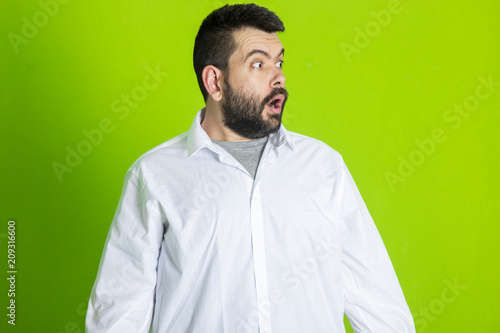 Portrait of young bearded man with shocked facial expression Poster