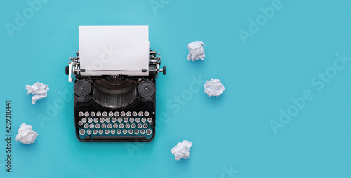 Vintage typewriter over blue background with copy space Canvas