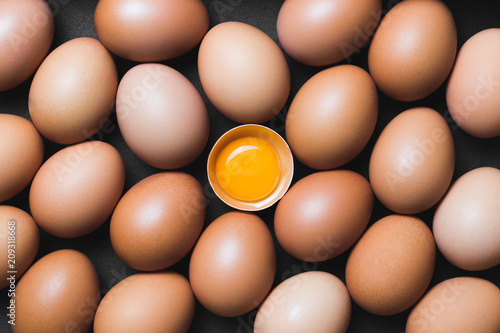 Canvas Print Chicken eggs and egg yolk,top view.