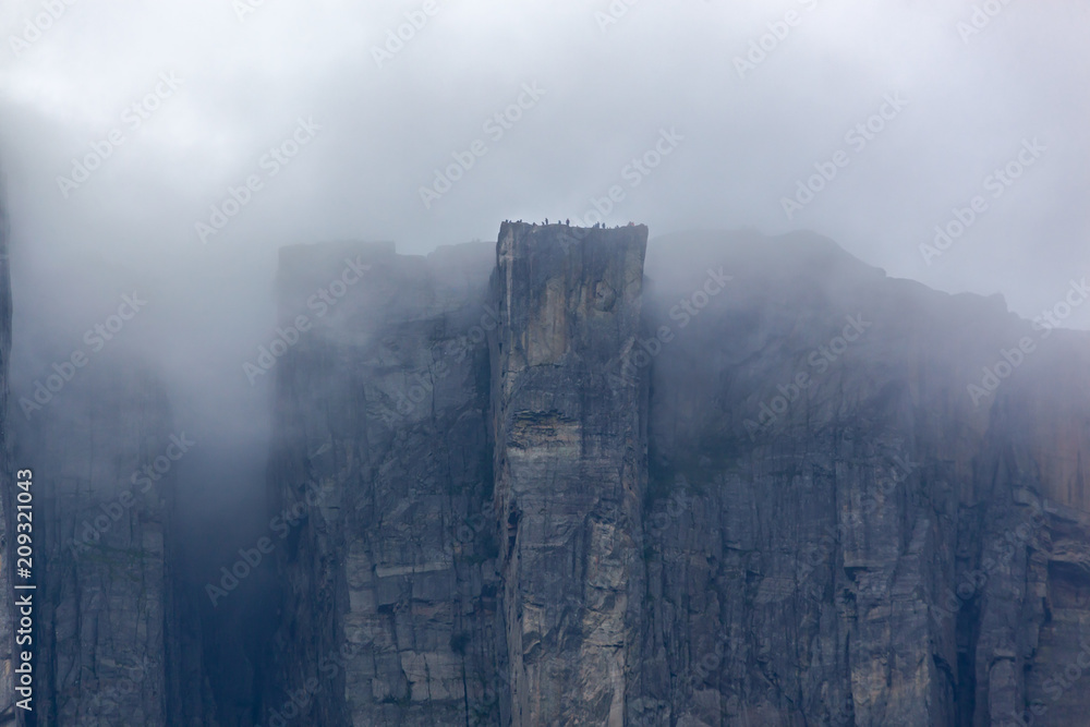 Fototapety, obrazy: View of Preikestolen steep cliff in fog from the Lysefjorden, Rogaland, Norway
