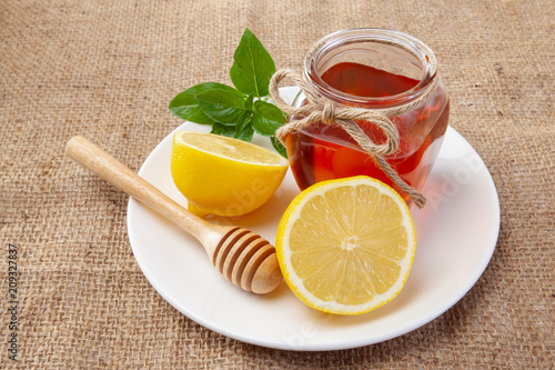Photo  honey, lemon and ginger on a wooden background