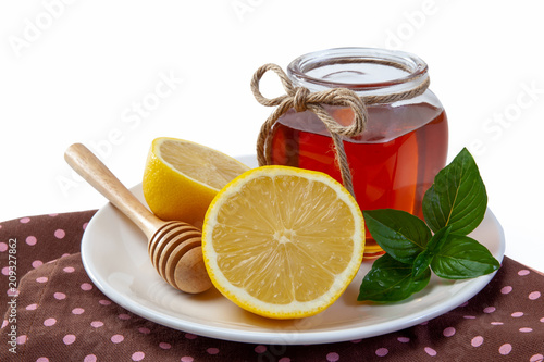 honey, lemon and ginger on a wooden background Poster