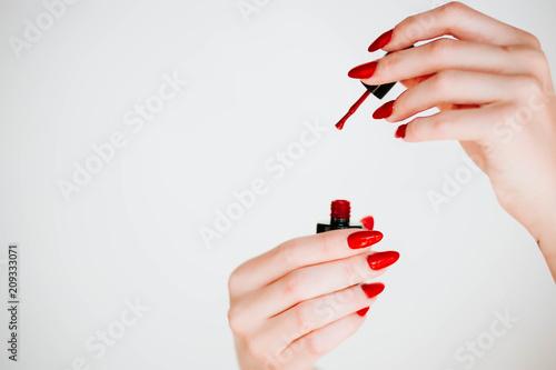 Fotografie, Obraz Beautiful girl showing red manicure nails