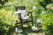 a wooden chair in the garden and a cup of tea