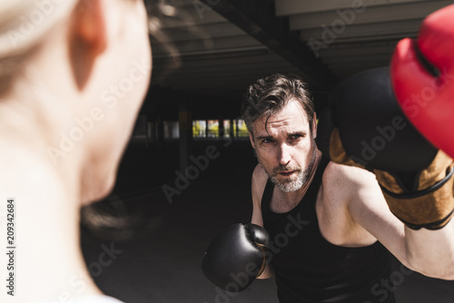 Man and woman in boxing training