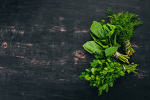 Spinach, Parsley And Dill. On A Wooden Background. Top View. Copy Space.