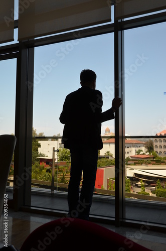 male silhouette on the background of a window overlooking Turkey
